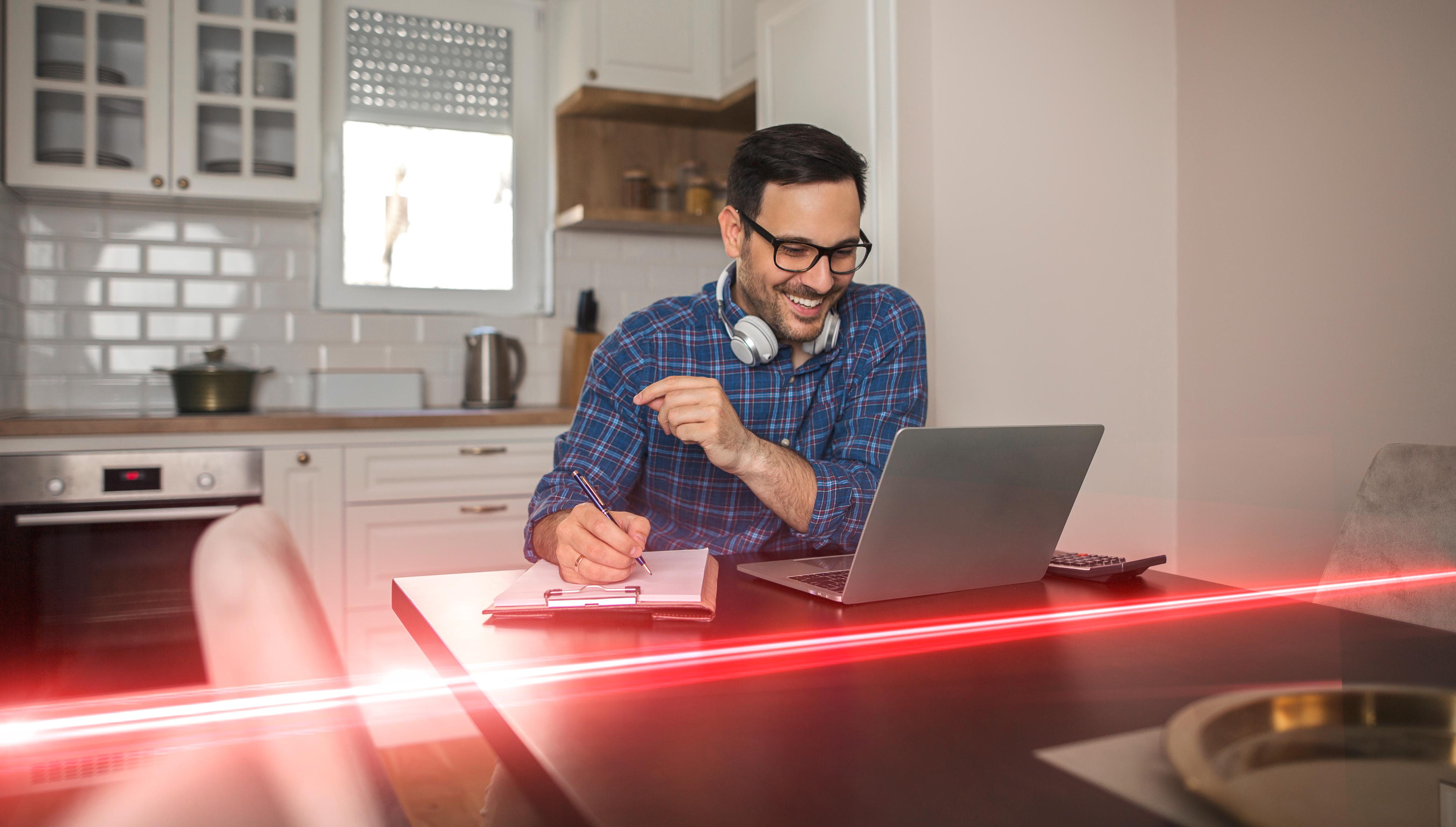 man sat at laptop with red eplan strobe